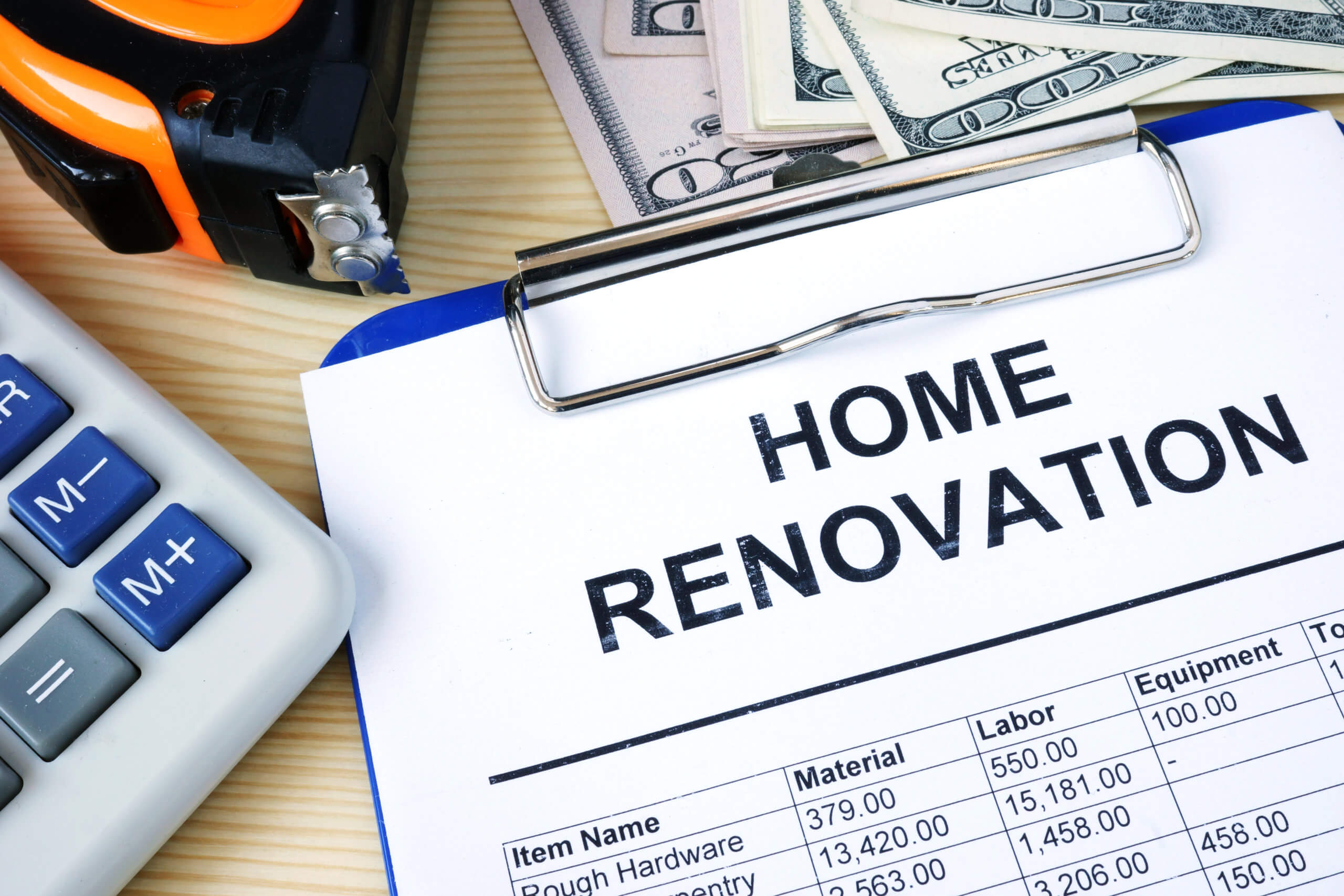 Clipboard with budget calculations about home renovation. Preventing Home Improvement Fraud